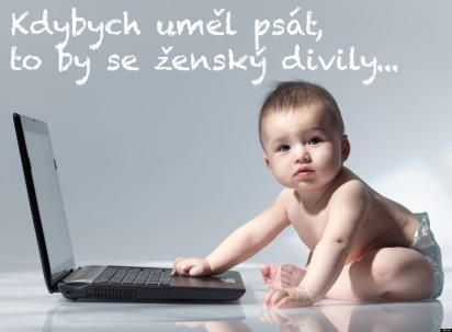 Six month old baby sitting in front of a laptop computer